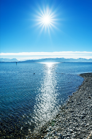 german swiss: An image of the alps at Lake Constance