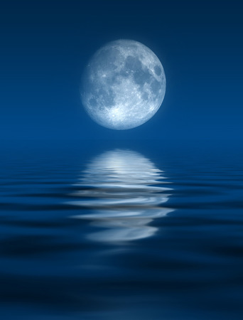An image of a nice and beautiful full moon over the ocean photo