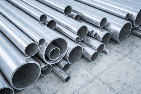 An image of some steel pipes in a warehouse Stock Photo