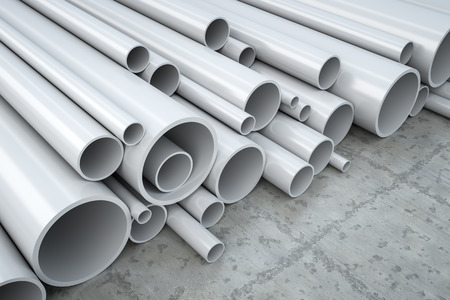 An image of some plastic pipes in a warehouse Stock Photo