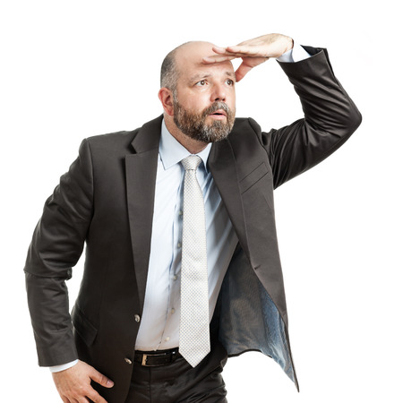 job searching: An image of a handsome seeking business man  Stock Photo