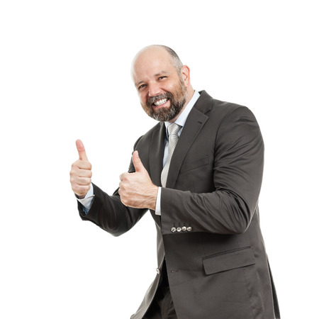 An image of a handsome business man with his thumbs up photo