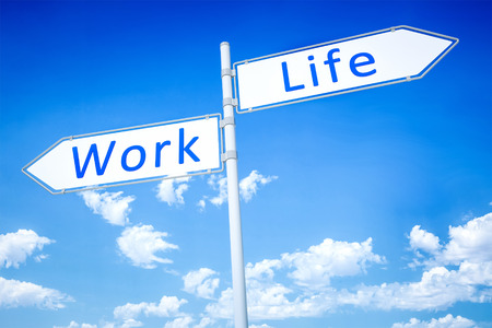 life balance: An image of a road sign with work and life Stock Photo