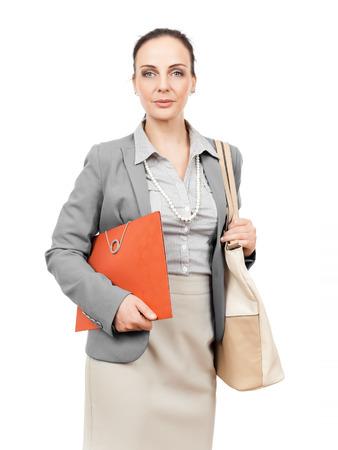 A business woman with a handbag and a folder photo