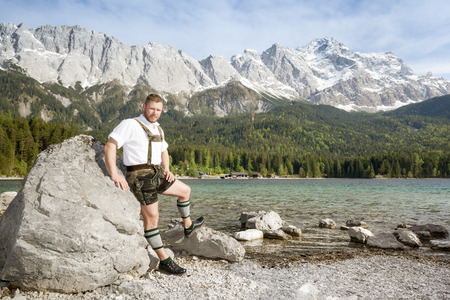 zugspitze mountain: A traditional bavarian man at lake Eibsee with the Zugspitze mountain