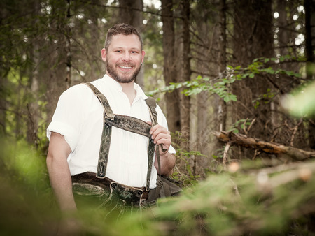 A traditional bavarian man in the nature photo