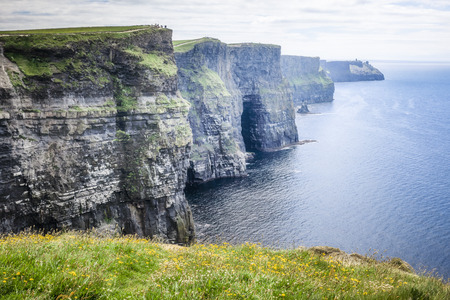 cliff edges: An image of the Cliffs of Moher in Ireland Stock Photo