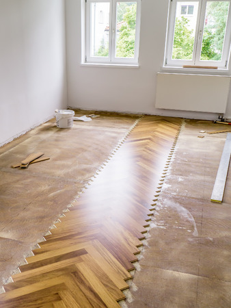 An image of laying a new parquet in the flat photo