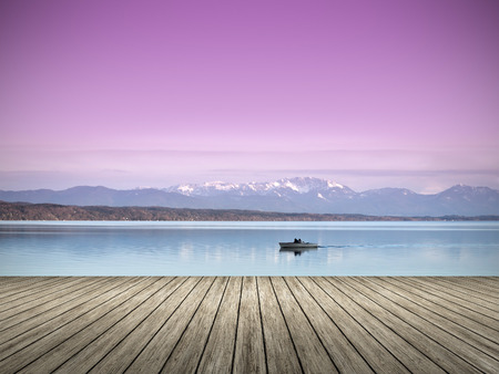over the hill: An image of a wooden jetty at the lake Starnberg in Bavaria Germany