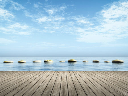 An image of step stones in the blue sea Reklamní fotografie