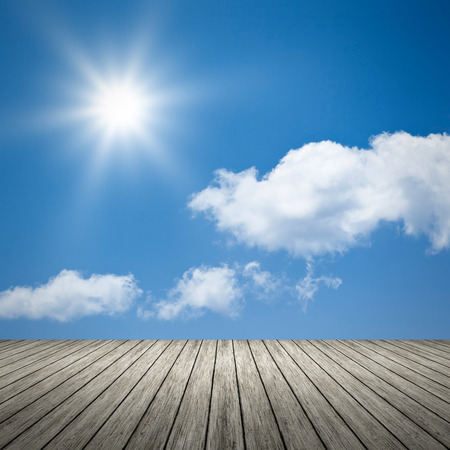 wooden dock: An image of a bright sun blue sky background