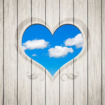 An image of a beautiful wooden heart clouds photo