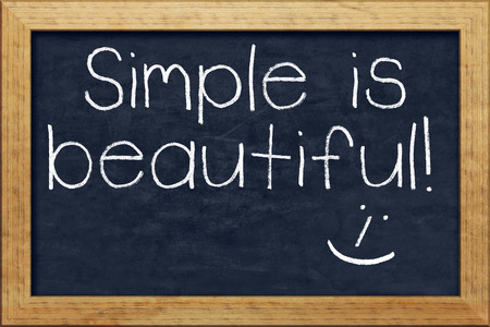 A nice black chalkboard with text simple is beautiful photo