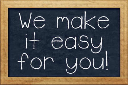 A nice black chalkboard with text we make it easy for you photo