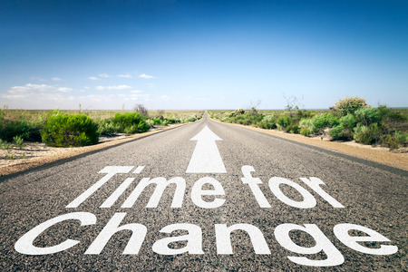 An image of a road to the horizon with text time for change