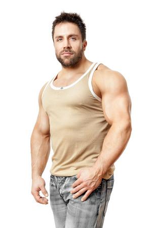 hombre fuerte: Una imagen de un apuesto joven, deportiva muscular