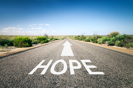 hope sign: An image of a road to the horizon with text hope Stock Photo