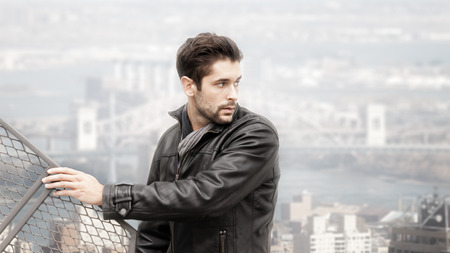 beautiful boys: An image of a cool young man above the city