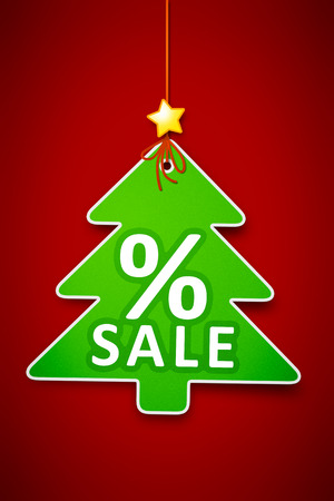 A beautiful green christmas tree tag on a red background sale photo