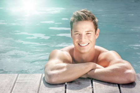 An image of a handsome young man at the pool photo