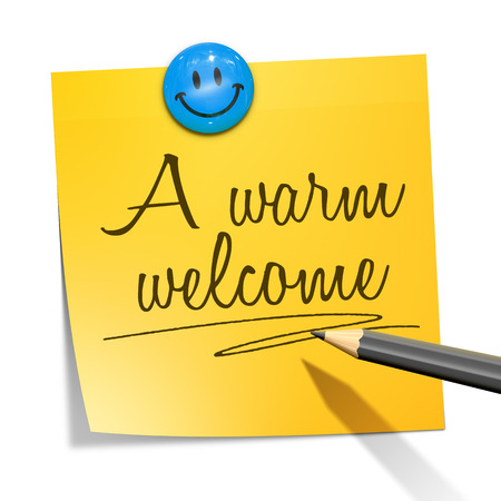 A sticky paper with the message a warm welcome Stock Photo
