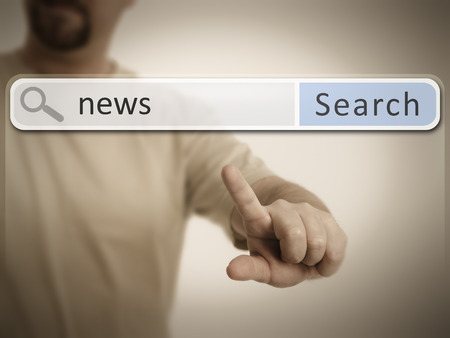 An image of a man who is searching the web after news photo