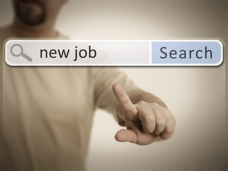 search bar: An image of a man who is searching the web after a new job Stock Photo