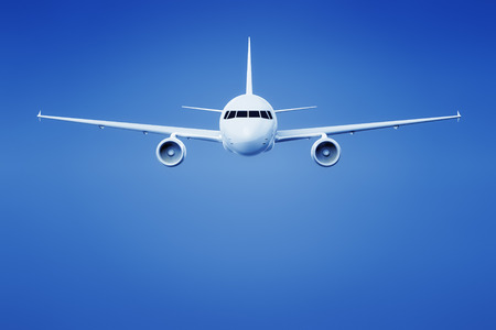 An image of an airplane in the bright blue sky photo