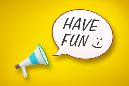 A megaphone and a speech bubble with the message have fun photo
