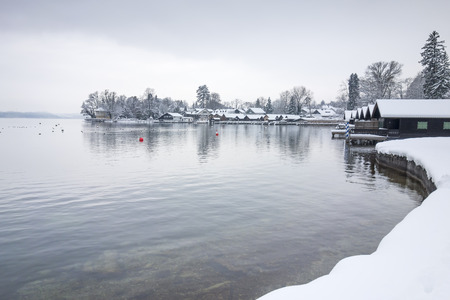frozen lake: Tutzing at Starnberg Lake covered in snow Stock Photo