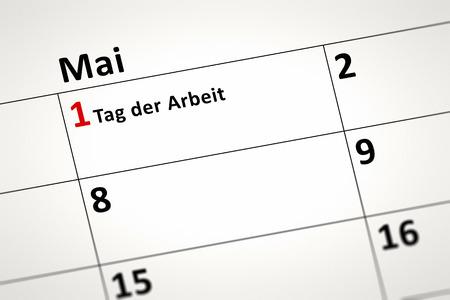 first day: An image of a calendar detail shows May the first Labor Day in german language
