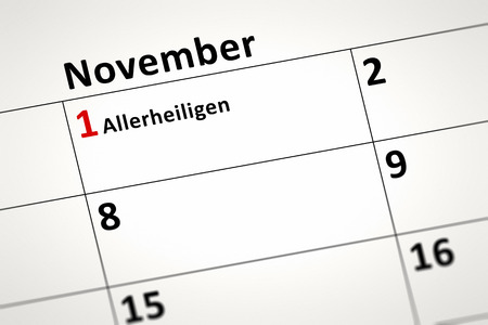 all saints day: An image of a calendar detail shows November the first All Saints Day in german language Stock Photo