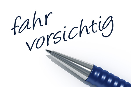 carefully: An image of a pen with the message drive carefully in german language