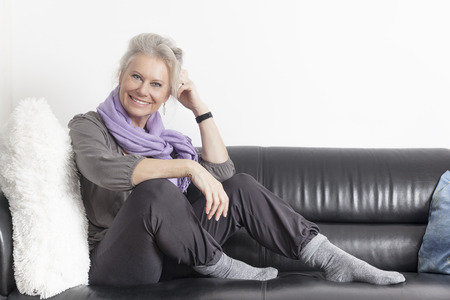 An image of a best age woman relaxing at home photo