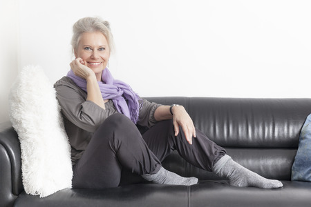 old sofa: An image of a best age woman relaxing at home