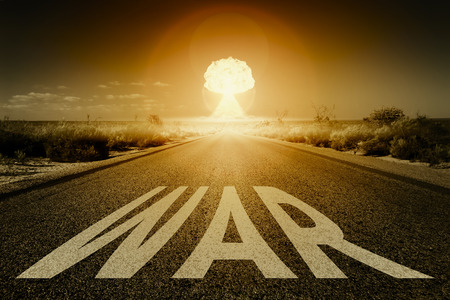 An image of a road to a nuclear bomb explosion with text war