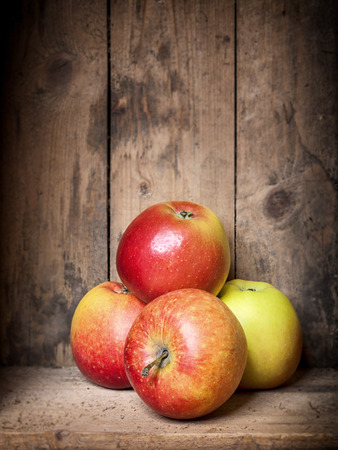 An image of some apples in a wooden box photo