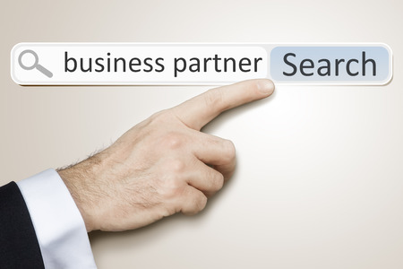 search bar: An image of a man who is searching the web for business partner