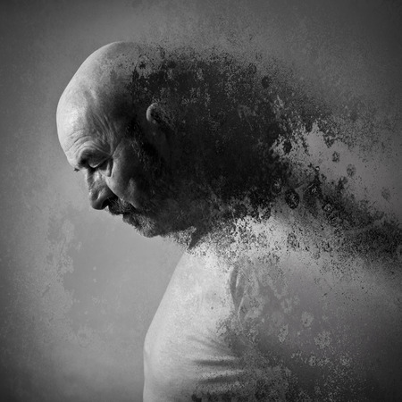 year profile: An old man with a grey beard in sorrow Stock Photo