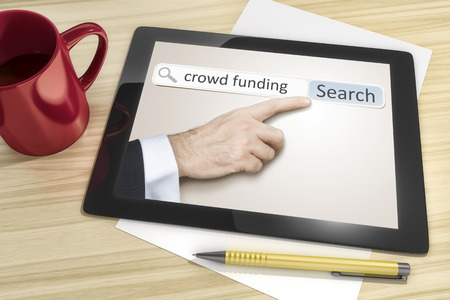 An image of a tablet pc with crowd funding internet search photo