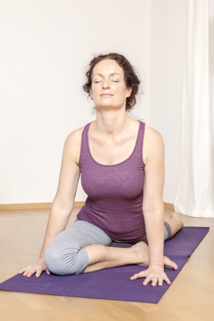 An image of a middle age woman doing yoga