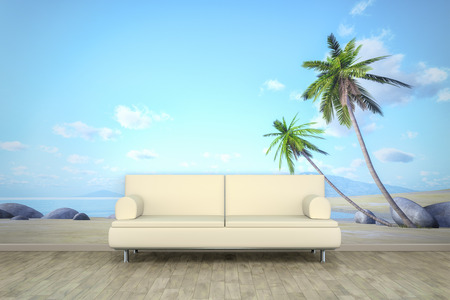 An image of a sofa in front of a photo wall mural with a palm beach