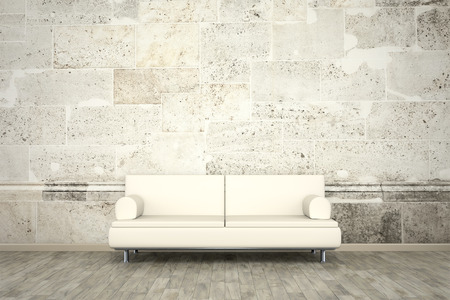 An image of a sofa in front of a photo wall mural stone wall Foto de archivo
