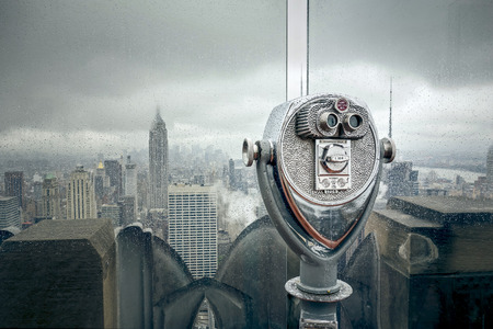 empire state: An image of New York at a rainy day binoculars Stock Photo