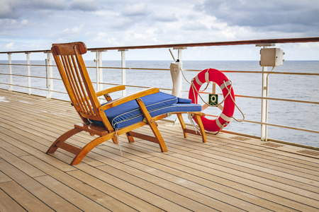 An image of a deck chair on a cruise ship with life-saver