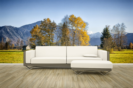 3D rendering of a sofa in front of a photo wall mural autumn landscape Stock Photo