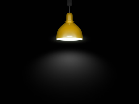 An image of a yellow lamp in front of a black background Stock Photo