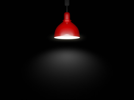 An image of a red lamp in front of a black background