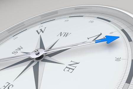 blue arrow: An image of a stylish compass with a blue arrow