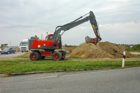 machinery machine: An image of a red excavator at work
